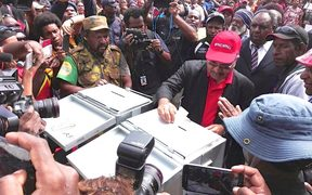 Papua New Guinea prime minister Peter O'Neill casts his vote in the 2017 election in his electorate of Ialibu-Pangia.