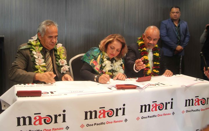 The signing of a partnership between the Maori Party and One Pacific.