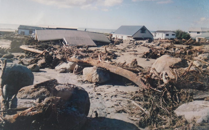 Homes in Matata were destroyed when intense rain forced debris into the community in 2005.