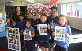 Mangere Bridge School students with the comic.