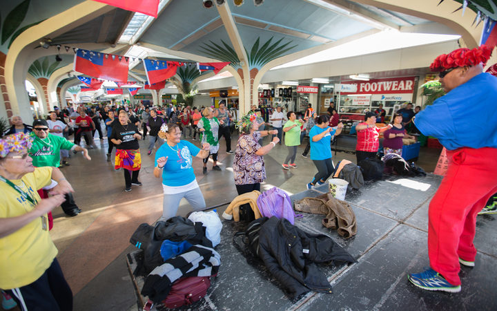 People take part in an open group Zumba session held in Mangere Town Centre