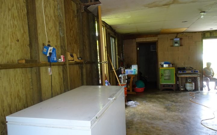 Police investigators discovered the body of three-year-old Ashley Marques in this freezer (foreground), and blood splattered on the floor leading to the room with the open door (back) where the body of her father, Robert Marques was found