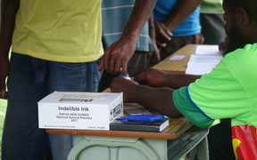 Indelible ink is used at a polling booth in Papua New Guinea's national election.