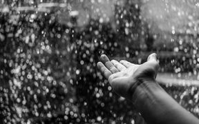 hand and raindrops