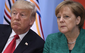 US President Donald Trump, left, and German Chancellor Angela Merkel at a panel discussion at the G20 summit in Hamburg, Germany.