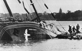 The Greenpeace flagship Rainbow Warrior lying in Auckland harbour after it was bombed in 1985.