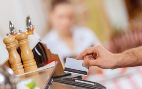Credit card transaction in a restaurant.