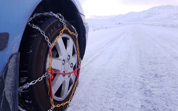 Snow in Tekapo, chains needed on road.