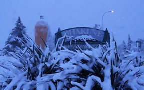 Ohakune's town sign and famous carrot covered in snow after the mid-July storm swept through.