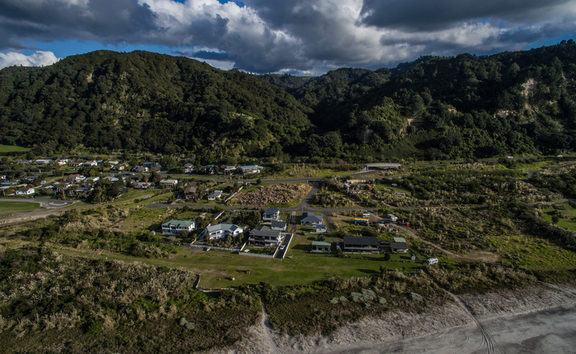 Some residential homes in Matata have been told by council that they are in an area at threat of a deadly landslip but residents don't agree.