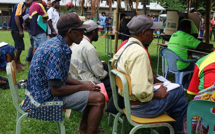 Scrutineers watch polling during the Papua New Guinea national election 2017.