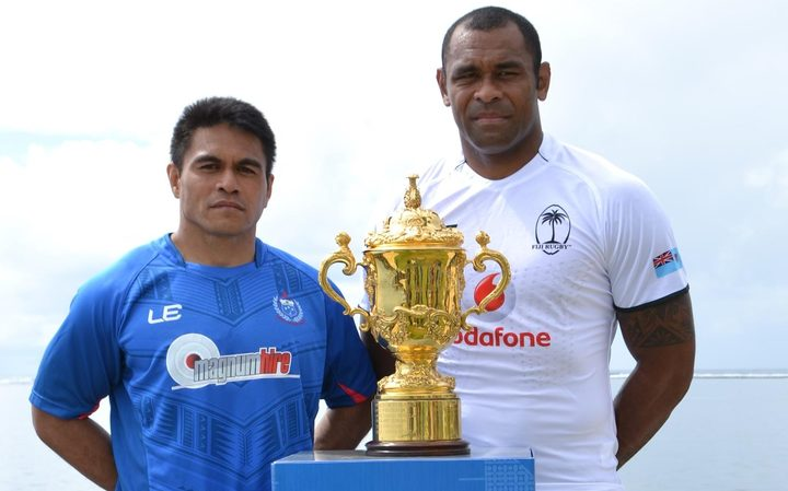 Samoa captain David Lemi and Fiji's Akapusi Qera pose with the Webb Ellis Cup ahead of Saturday's Pacific Nations Cup decider which doubles as a World Cup qualifier