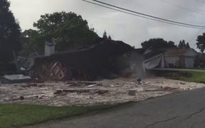 A house collapsing into a sinkhole in Florida.