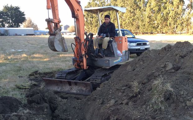 Josh Olykan burying the sheep that were attacked by dogs on his parents' property.