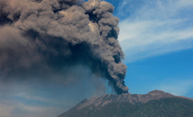 Mount Raung emits a column of ash and steam on 12 July 2015.