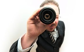 Man looking through lens
