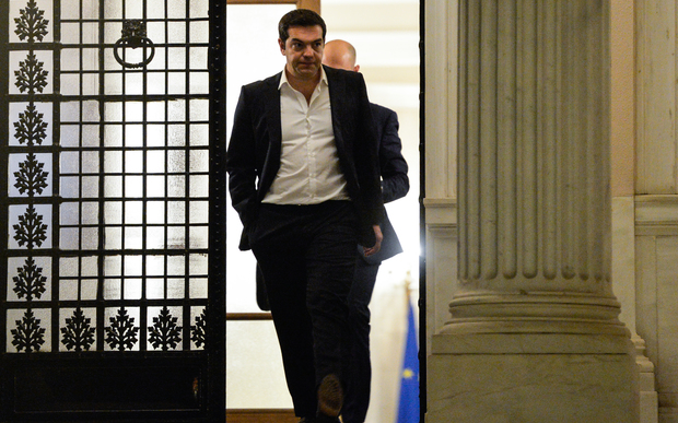 Greek Prime Minister Alexis Tsipras leaves his office after a day of political consultations in Athens on 14 July 2014.