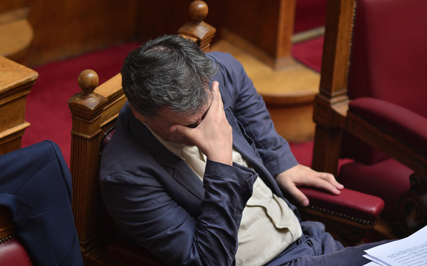 Greek Finance Minister Euclid Tsakalotos gestures during a parliamentary session in Athens on 15 July.