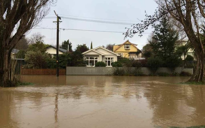 Eastern Terrace in Christchurch, where the water is high but receding, on Sunday morning.