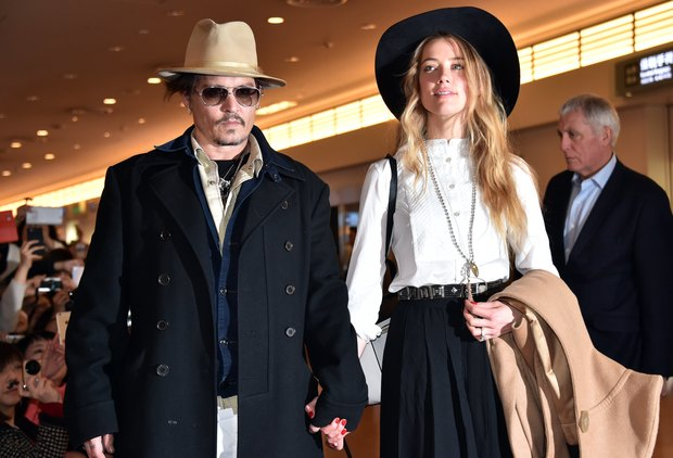 Johnny Depp, accompanied by his then-fiancee Amber Heard, at Tokyo International Airport on 26 January 2015.