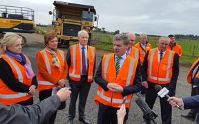 Government Minister Anne Tolley, Auckland Mayor Phil Goff, Prime Minister Bill English, Finance Minister Steven Joyce, and Auckland Deputy Mayor Bill Cashmore.