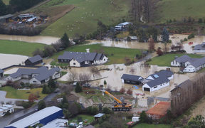 An aerial photo shows flooding at a new subdivision near Outram after the heavy rain over the weekend