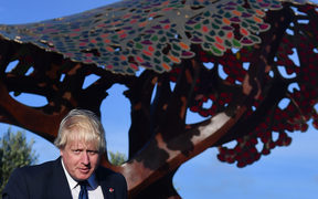 Boris Johnson in front of the Weta Workshop designed statue at the Pukeahu National War Memorial Park.