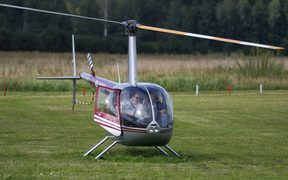 A file photos shows a Robinson R44 helicopter taking off in Latvia in 2011.