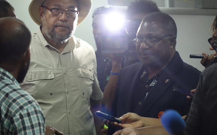 Glare of the media spotlight: Papua New Guinea Electoral Commissioner Patilias Gamato (in black) hears complaints about the 2017 election process by candidates (including Jamie Maxtone-Graham in hat) during polling.