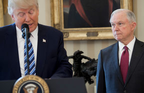 US President Donald Trump alongside US Attorney General Jeff Sessions after Sessions was sworn in as Attorney General in the Oval Office of the White House in Washington, February 9, 2017