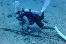 IT&E diver checks fibre optic cable.