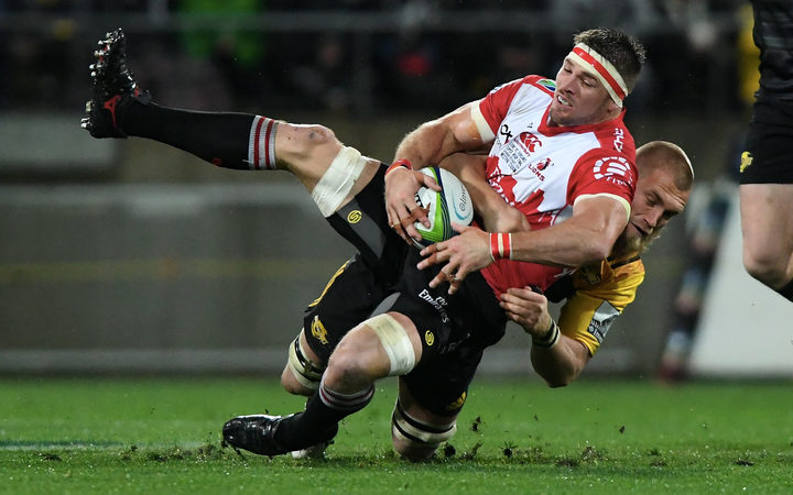 The Hurricanes' Brad Shields tackles the Lions Jaco Kriel in the Super Rugby Final, Hurricanes v Lions, Westpac Stadium, Wellington, Saturday, August 06, 2016.