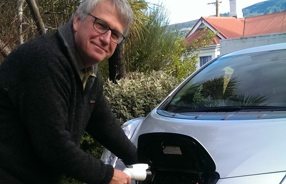 Henrik Moller plugs in his electric vehicle