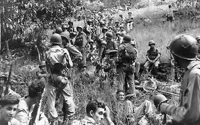 Marines rest in the field on Guadalcanal.