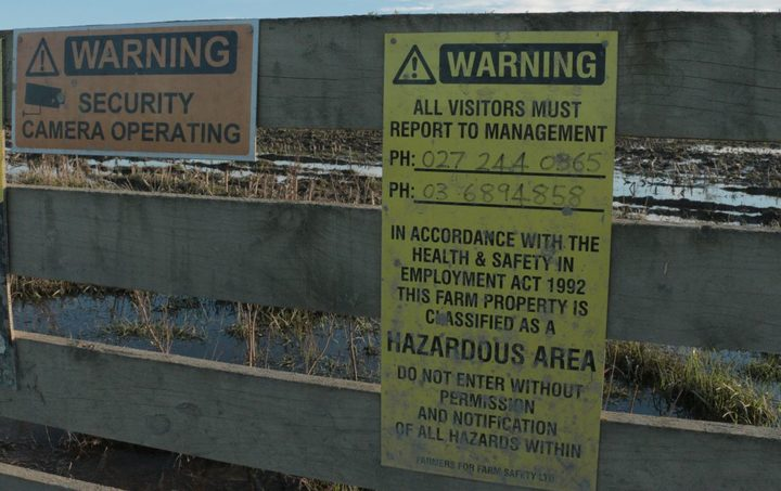 A warning sign on the gate of one of the infected farms.