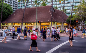 Busy intersection on Kalakaua Avenue on April 27, 2014 in Waikiki, Hawaii Kalakaua Avenue is the favorite luxury shopping strip for tourists visiting Hawaii