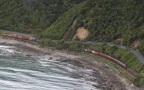 A train is trapped by landslides on the Kaikōura coast line.