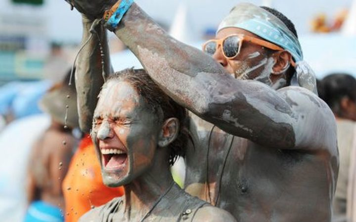 People enjoying themselves at the Boryeong Mud Festival in South Korea, the Rotorua festival's official partner.