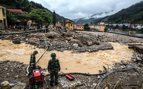 Soldiers operate a water pump amid destruction caused by flash floods in the mountainous town of Mu Cang Chai in the northern province of Yen Bai.