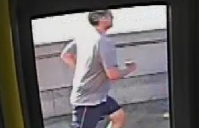 CCTV footage of a jogger who appeared to push a woman in front of a bus in west London