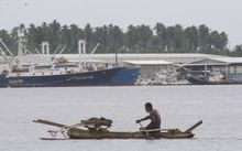 Fishing vessels, both modern and traditional, in the Madang lagoon, Papua New Guinea; part of the planned Pacific Marine Industrial Zone.