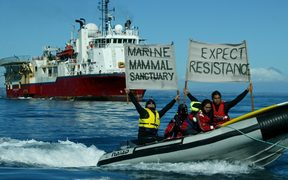 Protestors demonstrate before a prospecting vessel in Taranaki