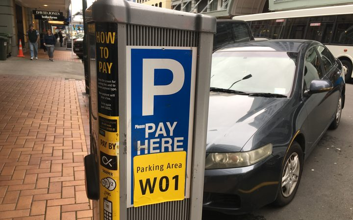 A file photo of someone paying for parking in Wellington's CBD