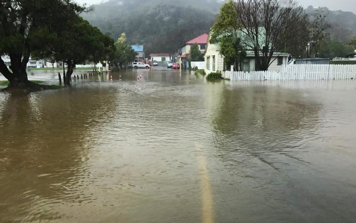 Akaroa has bore the brunt of wet weather in the Christchurch region as flooding and slips close roads.