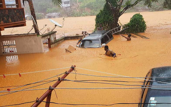 This handout picture released on August 14, 2017, by Society 4 Climate Change Communication Sierra Leone, shows flooded streets in Regent near Freetown.