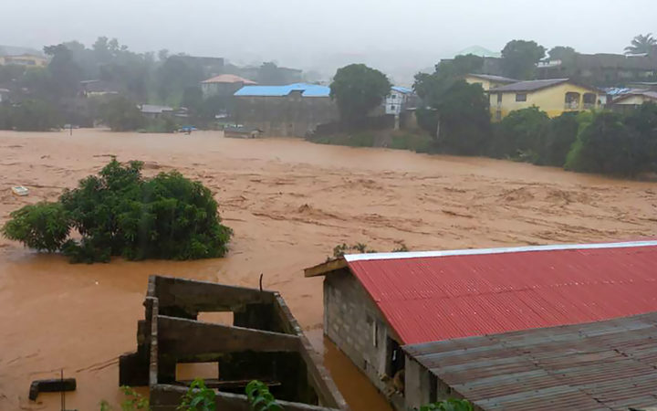 This handout picture released on August 14, 2017, by Society 4 Climate Chnage Communication Sierra Leone, shows flooded streets in Regent near Freetown.