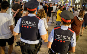 Police patrol Barcelona's Las Ramblas over the weekend following a terrorist attack that killed 13 people.