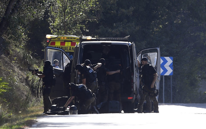 Bomb squad police at the site where Moroccan suspect Younes Abouyaaqoub was shot on 21 August 2017.