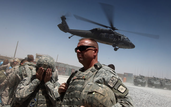 File photo showing US forces in southern Afghanistan in 2010, where a Black Hawk helicopter is lifting off from Camp Nathan Smith in Kandahar city.