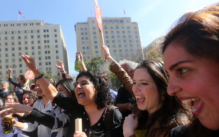 Pro-abortion activists celebrate outside the constitutional court in Santiago, Chile.